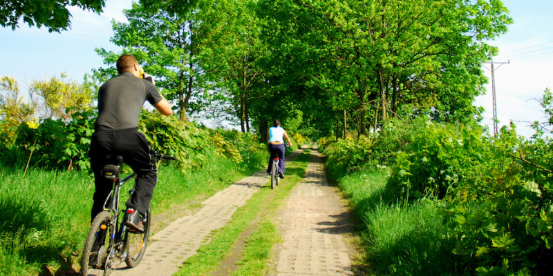 Couple Cycling In The Countryside