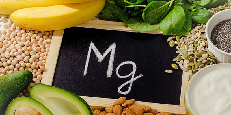 Image Of The Magnesium Synbol Mg And Foods Which Contain It