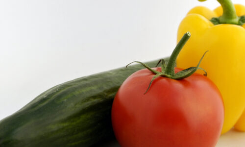 Image Of A Cucumber, Tomato And Yellow Capsicum