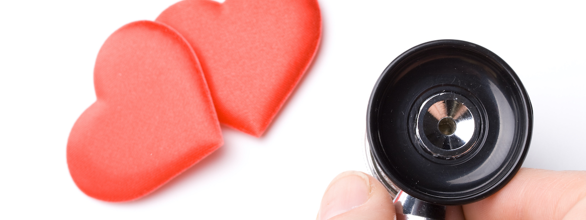 Image Of Two Hearts And A Hand Holding A Stethoscope