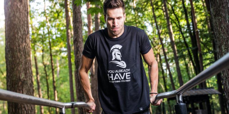 Man In Black T Shirt Exercising On Bars